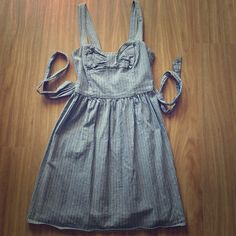 Striped Sweetheart Sundress Stretchy material, universally flattering and comfortable.  Grey with white pinstripes, and cute and fun now in the front. Ties at waist in the back.  Open to offers! Fire Los Angeles Dresses