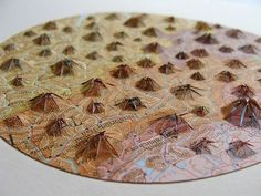 Maine based artist Shannon Rankin cuts, folds and collages maps to produce new maps which resemble their actual physical terrain. Contour lines are created by slicing the appropriate sections of the map and gluing them upon white paper. Mixed Media Collage, Collage Art, Sensory Art, Map Globe, Good Tutorials, Paper Artist, New World Order, Paper Cutting, Book Art