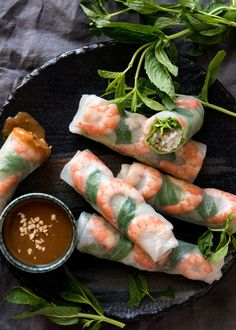 Fresh and healthy Vietnamese rice paper spring rolls with an amazing peanut sauce. Plus TWO secret tips to make it super easy to roll them up neatly!