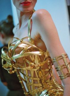 Gold glam bustier! Backstage at Jean Paul Gaultier Couture Fall 2012 (via Lingerie Lingerie!)