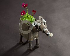 This elephant planter will drain water out the bottom and can be planted directly in. Each sculpture is handmade by Crysten Nesseth of Iron Maid Art. Elephant Planter, Iron Man Art, Metal Watering Can, Flower Pots, Flowers, Metal Art, Garden Art, Maid, Planter Pots