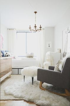 We could totally live in this nursery: http://www.stylemepretty.com/living/2015/07/13/modern-all-white-nursery-with-a-pop-of-pink/ | Photography: Claire Esparos - https://www.homepolish.com/