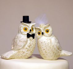 This snowy white owl wedding cake topper is handmade by CakeTopz and sold on Etsy for $85