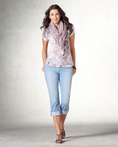 Print shirt, light wash jeans rolled up, scarf