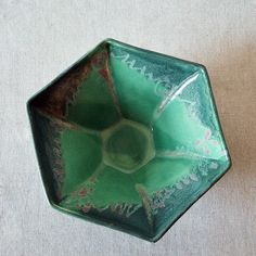 """Hexagonal studio pottery bowl with lovely purple and green drip glaze design. Amazing shape, and slightly amorphic. Signed """"Ingrid"""" en verso. Measures 10.5in diameter x 4in high."""