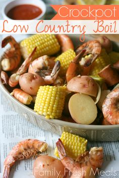 Crockpot Low Country Boil served in a grey bowl, sitting on newspaper sheets