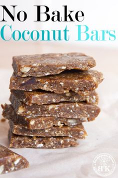 No Bake Coconut Bars - This recipe is gluten free, paleo, vegan, raw and grain free. If you looking for a homemade Lara Bars recipe, this is it! Get the recipe on The Bewitchin' Kitchen.