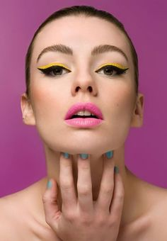 Makeup - Love the bubblegum lipstick and cat eyes. The blue in the nails is great - maybe bring that into the eyeshadow above the neon liner.
