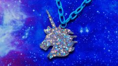 This handmade resin necklace is a cute unicorn set in a variety of glitters, from intensely shimmering rainbow silver holographic, to brightest