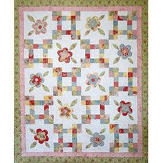 really sweet quilt pattern - uses jelly roll strips for blocks and layer cake squares for the flowers