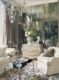 Houston home of Renea Abbott and Greg Manteris as seen in Veranda magazine | French Art Deco sofas in muslin. Antique Chinese-inspired French mirrors. Custom chests. Silk-velvet on pillows and chandelier, both Venetian. Table by Barbara Barry for Baker. Wallpaper and chair fabric by Kelly Wearstler for Schumacher. Costikyan rug. Art by Reuben Nakian | photo by  Casey and Anne Sills