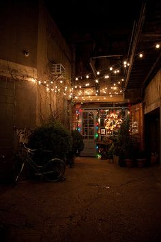 Bike at the entrance of Freemans, which is at the end of a long alleyway, by kitka.ca, via Flickr