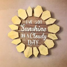 "KnotAndNestDesigns decor. I've got Sunshine on a cloudy day! This fun cheerful wood sign is absolutely adorable. The sign is made of thick wood and meaures 22"". Comes with a metal hanger"