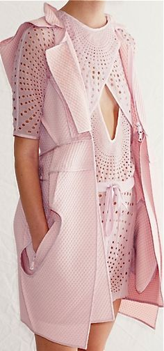 Vera Wang...wonderful structure,fabric design is stellar....great color, charm- simple design used to create a beautiful outcome