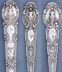 Details of the The John Philip Sousa Tiffany Sterling Silver 'Renaissance' Pattern Flatware. The Italian renaissance style featured a sculptural half-length naked female herme. She is partially covered by drapes and surmounts a pilaster decorated with a shell and surrounded by flowers. Winged caryatids are on each side of her.