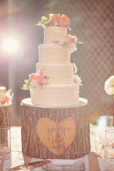 simple romantic wedding cakes tree stump cake stand is adorable with clusters of fresh flowers on the cake wright photographs