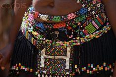 Africa | Traditional Beaded Clothing on Zulu Dancer.  PheZulu Village, South Africa | © Charles O'Rear