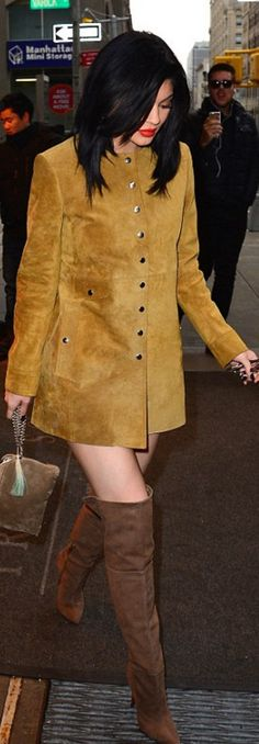 fdf4be9190df Who made Kylie Jenner's brown over the knee suede boots, snap button dress,  and