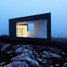 We're going to feature beautiful prefabricated homes from our archive today. First up is one of six artists' studios on Fogo Island off the coast of Canada by Saunders Architecture of Norway. Similar to local fisherman's houses, the studio sits on stilts and is clad in rough-sawn pine and whitewashed spruce on the interior. See more examples of prefabricated buildings on dezeen.com/tag/prefabricated-buildings #architecture #prefabricated #housing #studio #Canada