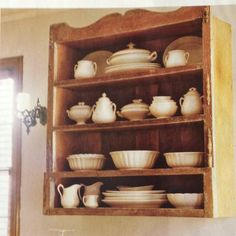 Salvaged dresser top on wall as hutch.