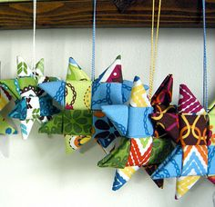 fabric star ornament tutorial -- very cute! :)