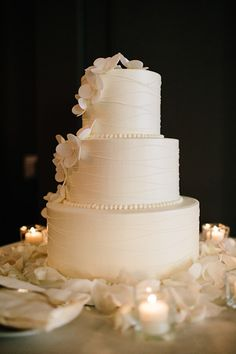 White Wedding Cake with Orchid Accents |Waldorf Astoria | Pen Carlson Photography | Sweetchic Events | Sarah's Pastries