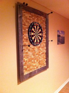 Creative corks around dart board.  Great look and protects the surrounding wall