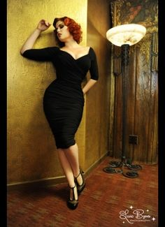 I love the vintage venue on this, and her pose is beautiful. I like posed against a wall shots, and fitted dresses on curvy ladies