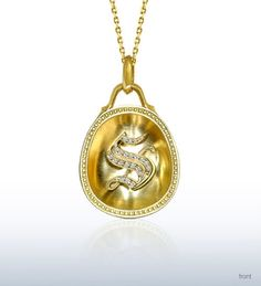"""Inspired by the Renaissance, this 18kt Yellow Gold and Diamond Old English Letter """"S"""" pendant from the Origins Collection was designed to bring one back to a time when personal pendants were not only the most coveted keepsake but also admired from - and worn on - both sides. Shaped like one half of a golden egg, the inside reveals the letter within a bold and refined rim, while the outer shell showcases intricate engravings inspired by the Letter S - an enchanting """"Sea"""" motif with an…"""