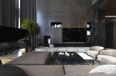 Three Luxurious Apartments With Dark Modern Interiors A tall storage unit seems to float above a marble sideboard. Carefully arranged wooden panels echo the geometry of the modular sofa, while open niches in matte black help disguise the television. Apartment Interior Design, Luxury Interior Design, Interior Exterior, Interior Design Living Room, Living Room Designs, Design Bedroom, Appartement Design, Living Room Arrangements, Dark Interiors