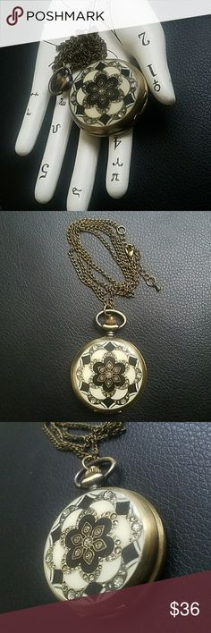 🚨SALE🆕Double sided pocket watch NWOT. So many beautiful aspects to this time piece. One side is a design embellished with silver shimmery circles on a black and ivory background. Needs new battery.  Feel free to ask any and all questions before purchase. Have a blessed day! ✌💚😄 Jewelry Necklaces