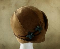 Clementine Brown This romantic cloche is handmade in the style of the 1920s and features a brim that flips up high on one side of the head