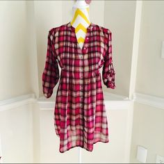 plaid chiffon tunic Very darling and cute. Chiffon tunic, thats sheer and flowy at the bottom. Tie back, no pockets. 3/4 sleeves American Rag Tops Tunics