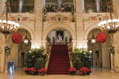 "The Great Hall decorated for Christmas, at the American Gilded Age era mansion, The Breakers, located in Newport RI. A portrait of Alice Vanderbilt, is displayed at the top of the Grand staircase. She, and her husband Cornelius Vanderbilt 11, were the original owners, and spent their summers here, in their ""cottage"". Architect, Richard Morris Hunt built the residence, from c.1893 - c.1895. ~ {cwl} ~ (Image: Town and Country Magazine)"