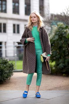 Hanne Gaby is feeling green in a sweater by Acne with matching cropped pants. #streetstyle #londonfashionweek #fashion #fashionweek #style #harpersbazaar #mrnewton
