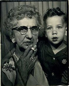 Shocked?  Well, how the hell else is the kid going to learn how to smoke, except from Gramma?  circa 1950 photobooth