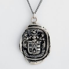 Love Conquers All Talisman NecklaceThis handcrafted talisman necklace reads Omnia Vincit Amor which means Love Conquers All in Latin..