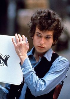 Bob Dylan on the set of his music video Subterranean Homesick Blues, 1965.