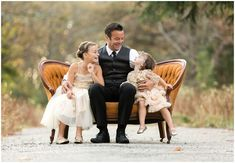 Outdoor family photography session with father and daughters on an antique couch on a dirt path; tutu du monde dresses, suit | Photo by Massart Photography, RI MA CT