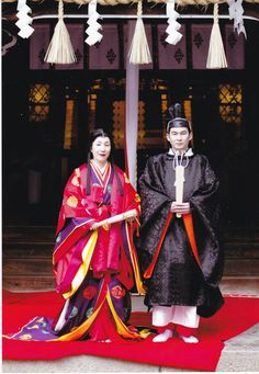 A couple dressed in heian era robes for their wedding