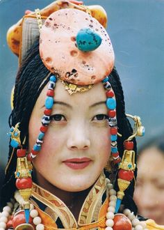 Tibetan young woman with traditional festive ornaments