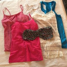 Lot of Tank Tops, Camis, and Bandeau Various tank tops and camis. Comes with all 3 camis, size medium, the blue tank top, size small, the white tank top, size medium, and the floral bandeau, size large. No signs of wear, stains, or damages of any sort. Smoke-free home. Tops Camisoles