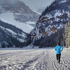 Frozen Lake - #Photo @mitchhull  24 degrees running Lake Louise. Akiko getting her morning run in across the frozen lake! #lakelouise - Welcome to #RunnerLand  Lets follow us & tag #RunnerLand in your photos for featured  -