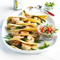 Fresh green beans and shrimp make the filler for these tasty tacos. A quick-fix tomato and cucumber salsa make a colorful, low-calorie topper.