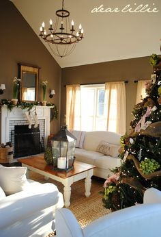 Curtains. Furniture. Wall paint...Sparrow by Benjamin Moore. Tree decor. Fireplace basket.
