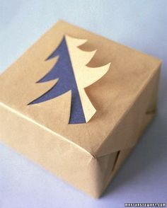Cut out half a tree on plain paper for some gift wrap with multidimensional interest!