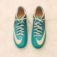 Nike Mercurial Woman's soccer shoes, never worn before. Size 7 but fits like 6.5! Nike Shoes