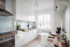 Een Scandinavisch appartement met subtiele kerstversiering - Roomed