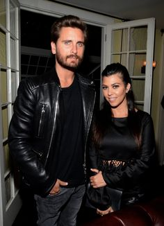 Pin for Later: Last Night's Kardashian Dress Code: Leg Slits and Crop Tops Only  Kourtney brought along Scott Disick, who kept it cool in his leather jacket.