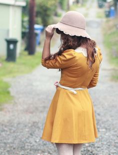 Mustard yellow dresses and hats